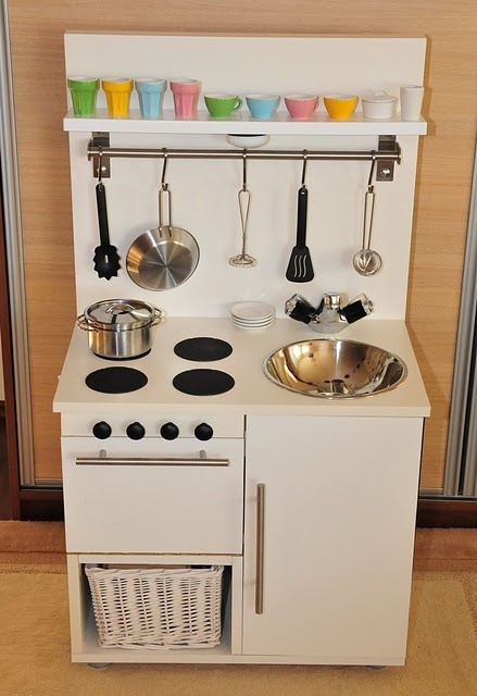 """Ikea hackers play kitchen. Love the stove top """"burners"""" (coasters) and light under the top shelf."""
