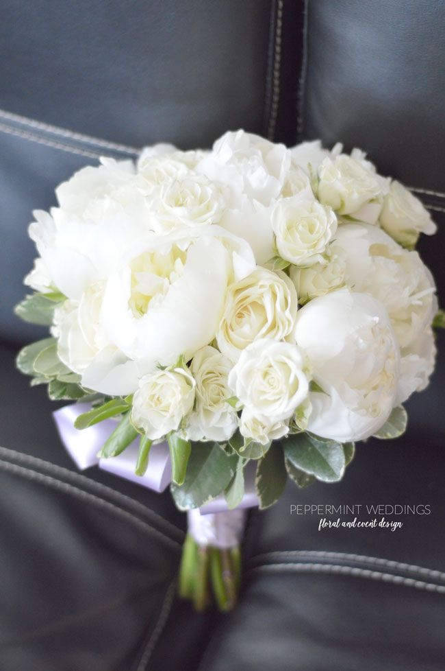 white peonies white spray roses and white roses wedding bouquet with lilac ribbon wrap