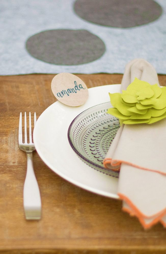 Looking for wedding centerpieces or dinner party inspiration?  We think you'll love this budget-friendly décor idea for napkin folding and place cards. Click in to see how we created this beautiful table setting.