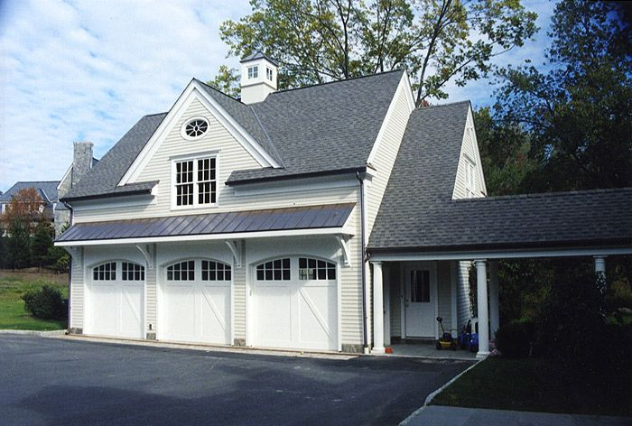 Garage door metal roof overhang the covered breeze way is for Garage addition designs