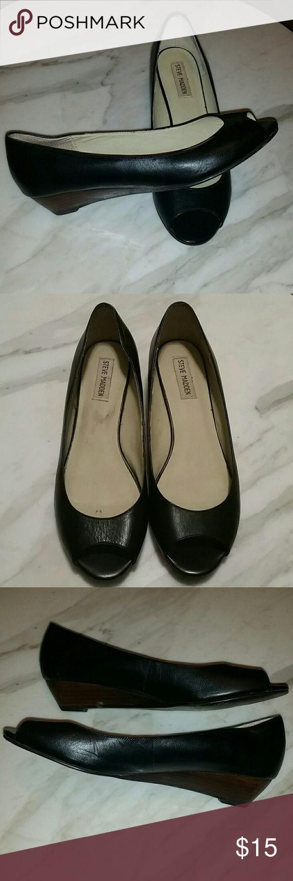 Steve Madden peep toe wedge heel Black peep toe shoe with a  brown wedge heel.  Slight wear on the backs of shoe. Steve Madden Shoes Wedges