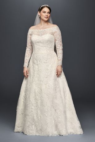 Elegant and opulent, the lace design of this plus size A-line gown was inspired by ornate motifs found in royal palaces. Crafted with three types of lace and 2,000 beads and sequins, this magnificent, off-the-shoulder wedding dress is nothing short of regal.