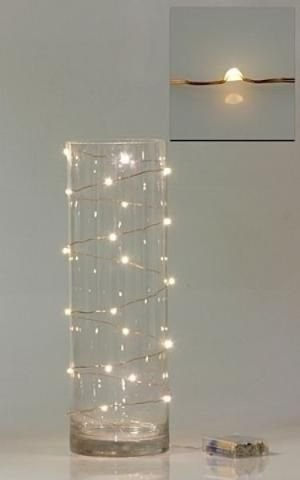 #Fairylights even look pretty on the outside of a vase. Wired Fairy Lights | DIY Wedding Company by MarylinJ