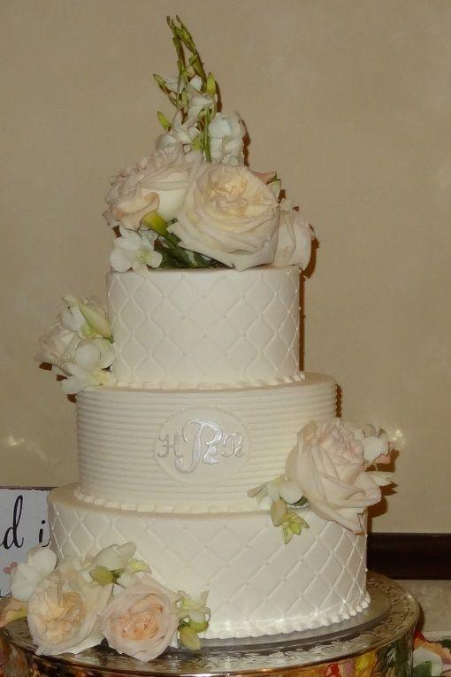 Elegant oval-shaped white wedding cake.