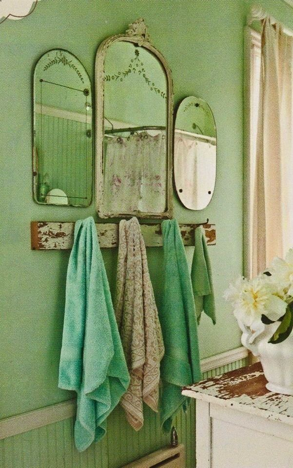 I would so do this! The mismatched vintage mirrors, the barn wood coat/towel hook rack. Perfect (even for the entry)