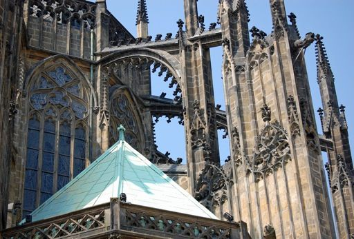 These flying buttresses are a feature of gothic architecture. They're part of the St Vitus Cathedral in Prague Castle.