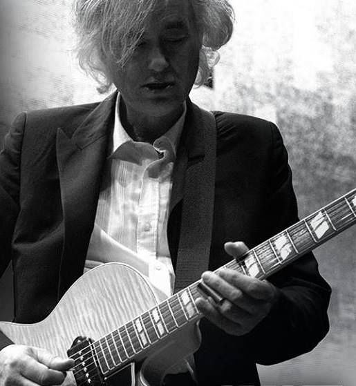 Jimmy Page, playing slide guitar, somethig he does well but not very often.