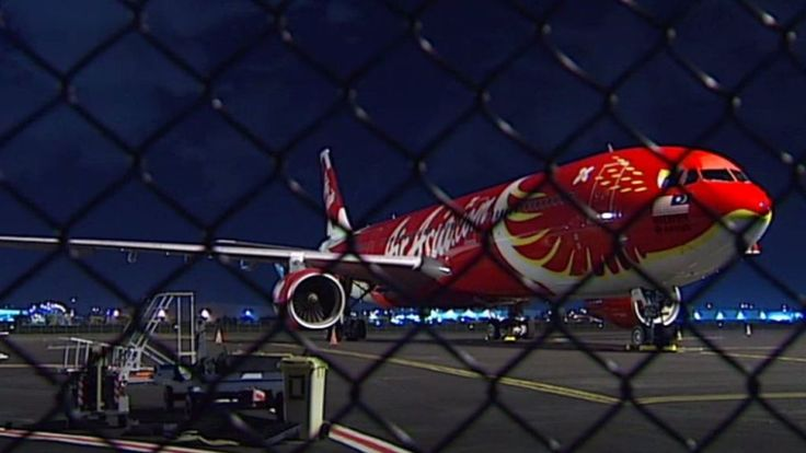 The AirAsia X plane let off loud bangs and sparks before landing safely in Brisbane, passengers say.