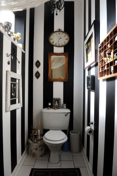 love the stripes, would get rid of all the crap hanging on the walls and add a bigger mirror behind the toilet. Probably would put a much bigger chandelier, too.