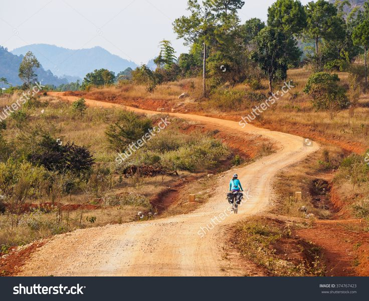 Cycling On An Unpaved Road In Myanmar Stock Photo 374767423 : Shutterstock