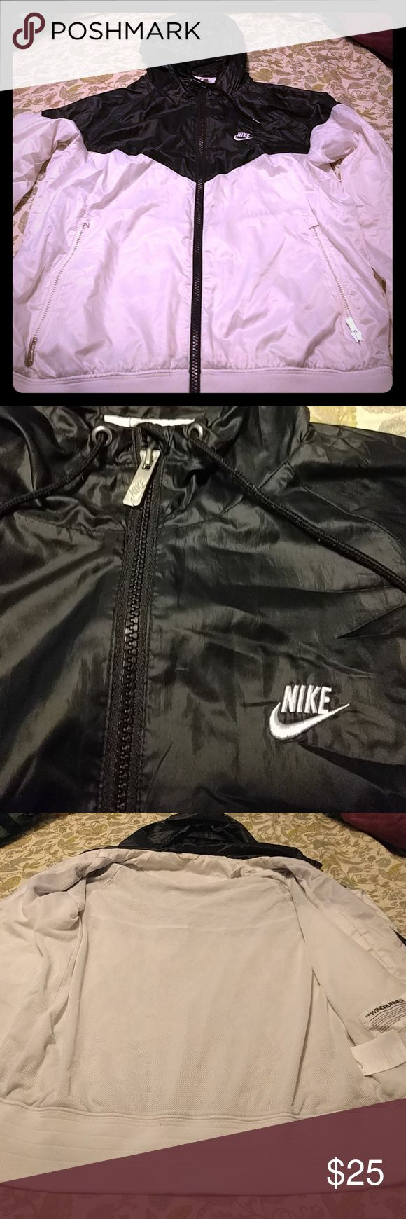 Nike windrunner jacket Black and White Nike windrunner. Good used condition, slight discoloration near wrist as seen in last picture. Looks like it would come out with proper cleaning. Hardly noticable as it is. Nike Jackets & Coats