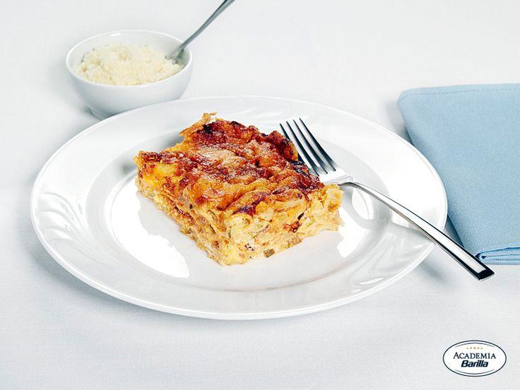 Lasagne alla Bolognese con zucchine e speck croccante