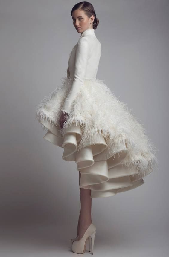 ASHI STUDIO s/s 2014 #dressoftheyear nomination( this because she looks like a swan....I wouldn't wear this... id look like a snowperson... and not in a good way