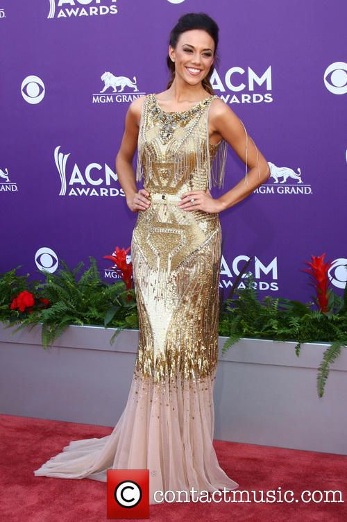Jana Kramer another pose in the same gold dress