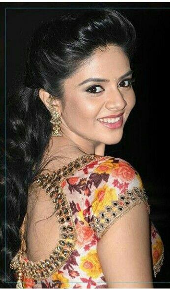 Sreemukhi in floral blouse..