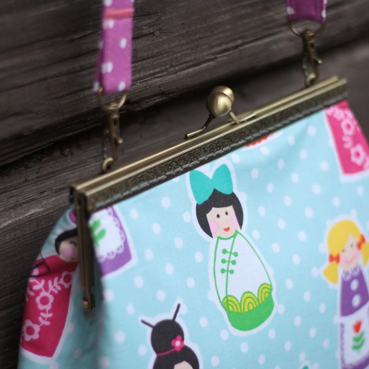 Matrioshka pattern frame handbag. Not a small one - it can carry lots of things, with its size: 28 x 25 x 4 cm, adjustable length shoulder strap up to 140 cm.