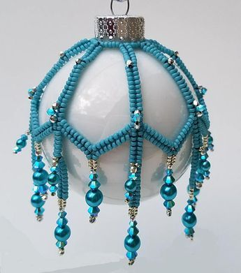 "New for 2017! Weave seed bead Ribbons of herringbone and embellish with lots of Icy Swarovski crystals and pearls to create a beautiful Victorian style ornament cover. The open bottom allows for changing/replacing the glass ornament bulb. Materials Japanese seed bead size 15 ̊ Japanese seed bead size 11 ̊ Tru2 Fire-polished rounds 3mm Bicones 4mm Bicones 4mm Pearls 6mm Pearls 2½"" diameter Round Ornament Tools Beading Needles size 10 or 11 Nylon beading thread – One-G or Fireline 6 lb ..."