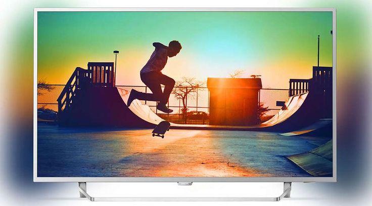 """Philips 49PUS6412  Description: Philips 49PUS6412/12: 49"""" Ultraslanke 4K LED-TV De Philips 49PUS6412 is functioneel en heeft een mooi design. De 49PUS6412 brengt je entertainment tot leven met een spectaculaire 4K Ultra HD-resolutie. En dankzij Android TV zijn jouw entertainmentmogelijkheden vrijwel eindeloos. Deze televisie is voorzien van HDR Plus en DTS-HD zodat jij scènes kan zien en kan horen zoals ze bedoeld zijn. De Ambilight van de Philips 49PUS6412 veranderen je manier waarop je tv…"""