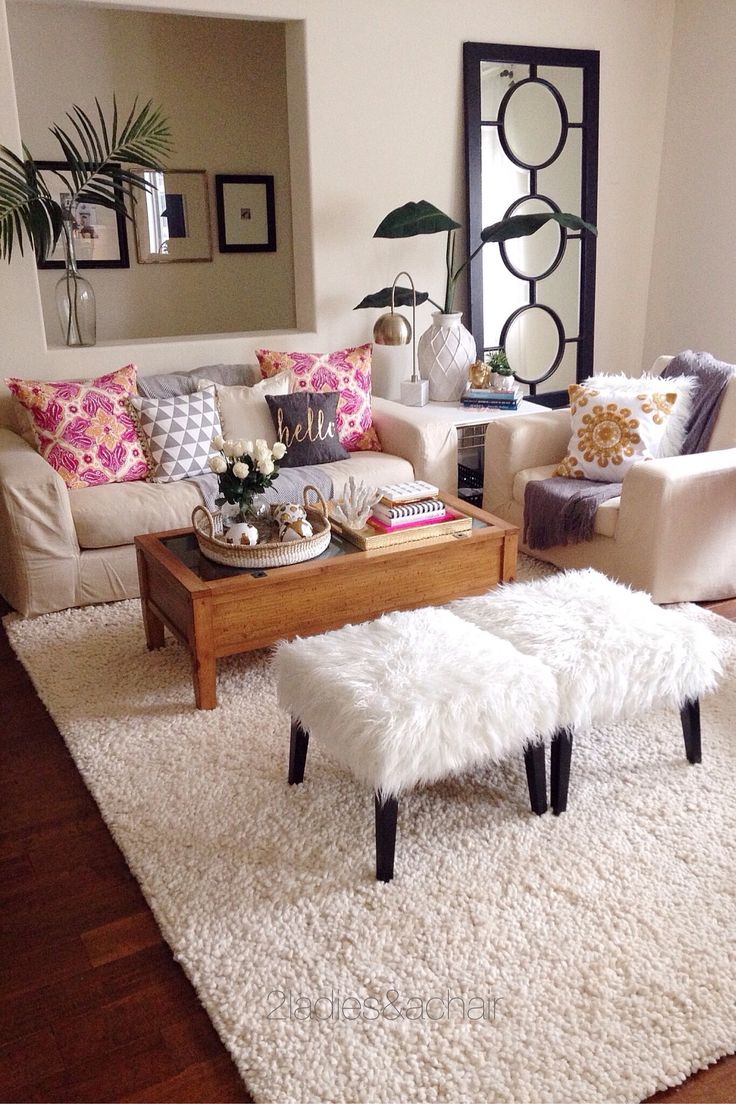 To unify this colorful space we used white faux fur. You will notice the placement of faux fur is scattered yet balanced around this living room. It helps to neutralize the bold color and patterns of the pillows while creating an atmosphere that's fun and refreshing! All our faux fur pieces are from HomeGoods. Sponsored by HomeGoods