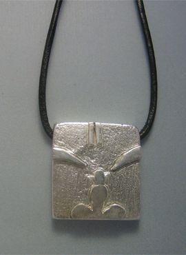 talismanes amuletos y símbolos   colgante sello maya mono Kin Chuen