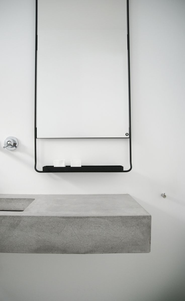 white concrete and black bathroom