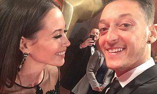 http://www.dailymail.co.uk/sport/football/article-3316735/Arsenal-ace-Mesut-Ozil-reunited-red-carpet-singer-Mandy-Capristo.html
