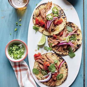 Slow cooking tougher cuts of meat, such as beef brisket, gives you a meltingly tender texture. For tacos, serve the saucy barbacoa in tortillas with green and red onion, cilantro leaves, jalapeño slices, and fresh lime wedges.
