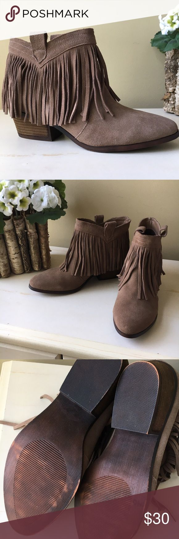 NWOT Suede Fringed Ankle Boots Sz 9 NWOT Suede, fringed, western-style ankle boots. I've sprayed the with water repellant. They have some orange paint on the back of a couple pieces of fringe on the outside of the left boot. Soles have a distressed look. Never worn outside. Size 9 Restricted Shoes Ankle Boots & Booties