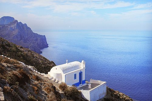 Small Church at hillside in Olympos Village overlooking the Aegean Sea in Greece