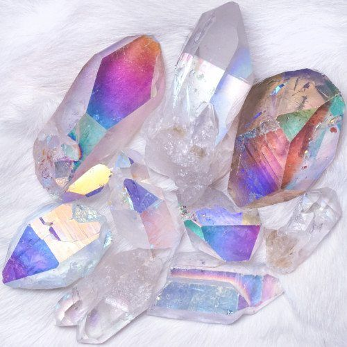 Opal Aura Quartz Points for psychic awareness. These Opal Aura Quartz Points have unique and magical markings in addition to the power, energy, and beauty of the aura treatment. ($17.00-$39.00)  https://occu.info/what-is-a-psychic-reading/