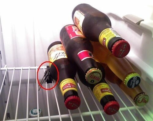 Easy beer storage solution: use a binder clip to keep bottles from rolling.