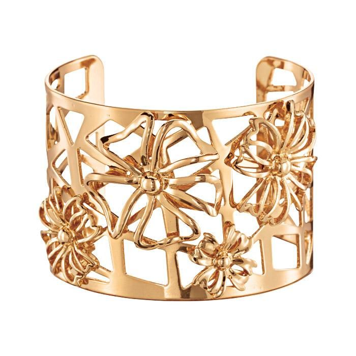 Bring on spring with the Floral Collection—glass stones and goldtone set in arrangements blooming with beauty.FEATURES• Openwork flowers surrounded by lattice work• One size fits most MATERIALS• Goldtone metalImported