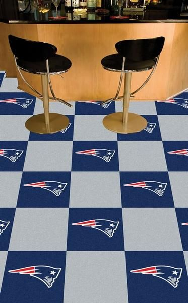 Display your favorite sports team while adding color and style to any room in your home with these New England Patriots Team Carpet Tiles by Fanmats. These team