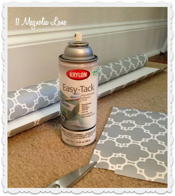 Easy-Tack, also called photo mount, this spray on adhesive made wrapping and scrapbook paper more like vinyl or shelf paper. It's repositionable, and when the time comes to move, just peel it off and wipe any remaining residue off with a bit of polish or oil.