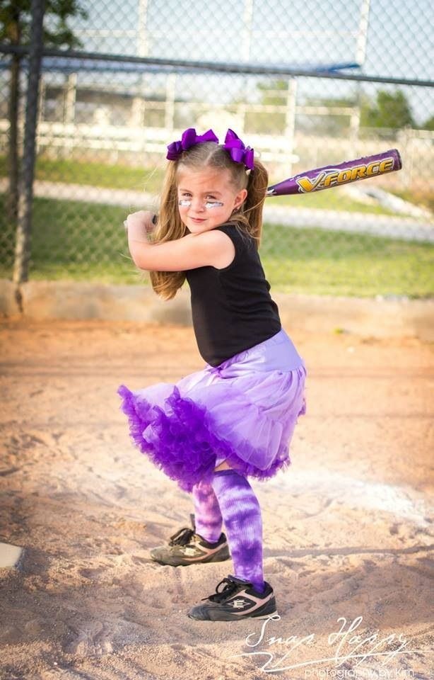 Glamour softball picture. Purple tutu, jersey.