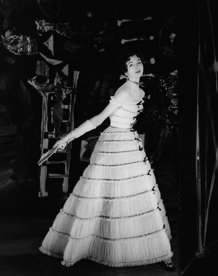 Model wears Balmain gown, 1954