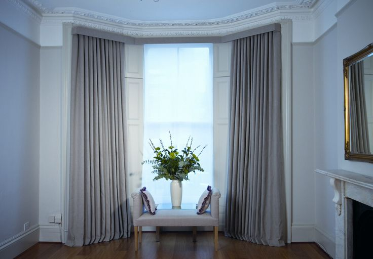 If a pelmet is needed then this is sweet, small and narrow but does look elegant in a large window.  'Bay pelmet with angular bends and with Poligny curtains with inverted pleat heading'