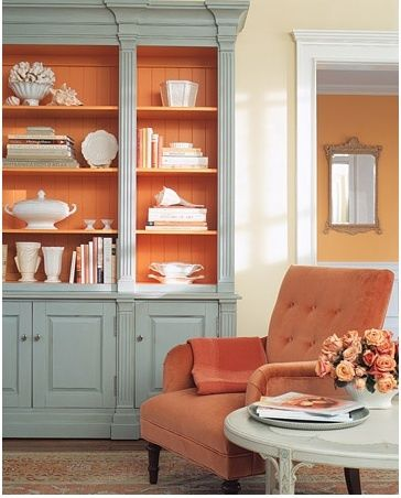 I think painting the inside of bookshelves is fascinating, as is including other items beside books on the shelves. Also, this paint color (Martha Stewart's Butterscotch) is up for consideration as an accent wall in my bedroom. Wondering if it's too bright for one bedroom wall...