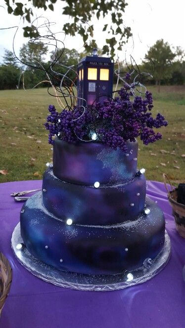 Our TARDIS wedding cake. It went great with our space theme. It has a nebula airbrush on fondant. We had blue raspberry, chocolate and strawberry cake layers. ♡ Doctor Who                                                                                                                                                     More