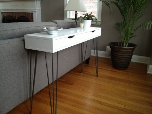 Console storage table: Use the IKEA Ekby Alex shelf with the addition of some hairpin legs.