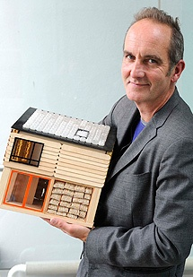 Kevin McCloud with a model of The House that Kevin Built: The House was constructed live on TV in 6 days in 2008 for Channel 4's Grand Designs Live - the UK's first low-energy prefabricated house made from eco-friendly materials. It was later dismantled but the concept is being reborn in the courtyard of the university's Faculty of Arts, Brighton http://arts.brighton.ac.uk/business-and-community/the-house-that-kevin-built/the-thtkb-waste-house-videos/waste-house-media-presentations#