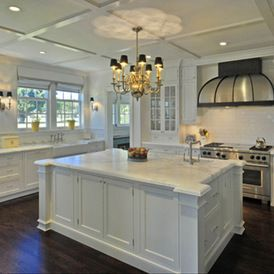 traditional kitchen by Nelson de Leon/Locus Architecture Inc. featuring white kitchen cabinets and white marble countertops