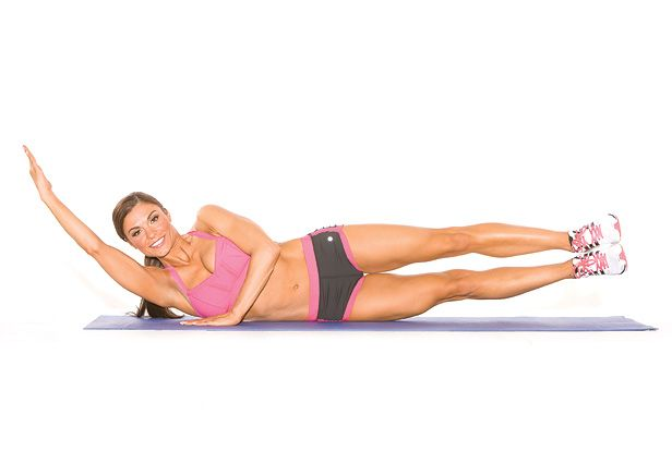 Side-Lying Obliques Crunch - Set Up: Lie on your right side with your legs stacked and your right arm extended beside your ear [A].    Action: Contract your abs and simultaneously lift your right arm and legs from the floor, supporting yourself with your left arm [B]. Hold for one count before lowering back to the start. Do three sets of 10 reps on each side.