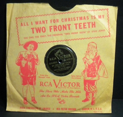 All I Want For Christmas Is My Two Front Teeth! Vintage 78 RPM Record in original sleeve with Santa on the front and back. Spike Jones and his City Slickers perform. Happy New Year on the reverse. Raucous fun with interesting New Years resolutions!