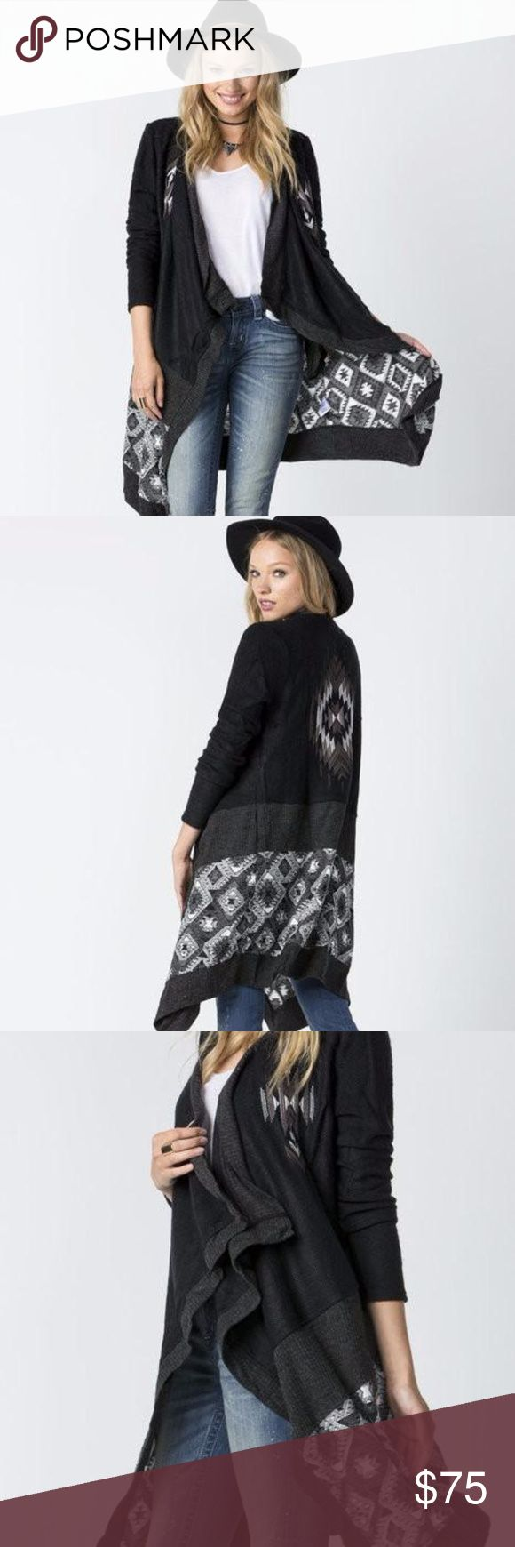 """SALE! Miss Me Southwestern Knee Length Cardigan This cardigan with keep you warm and chic all season long!  Details include tribal pattern at back and bottom half, knee-grazing length, drapy collar, and contrast ribbed trimming throughout.  100% Acrylic Imported Machine Wash Mixed media fabric accent details Long sleeve  Ssize2/4bust34 - 35""""waist26 - 27"""" Msize6/8bust36 - 37""""waist28 - 29"""" Miss Me Sweaters Cardigans"""