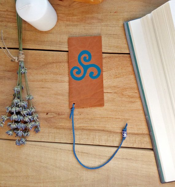 Check out this item in my Etsy shop https://www.etsy.com/listing/501630703/triple-spiral-bookmark-wiccan-bookmark