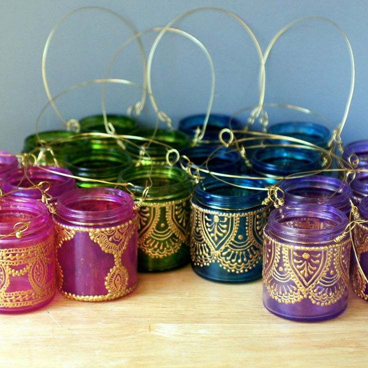 Moroccan Lantern Hanging Jar Candle Holder with Teal Glass and Golden Detailing. $12.00, via Etsy.