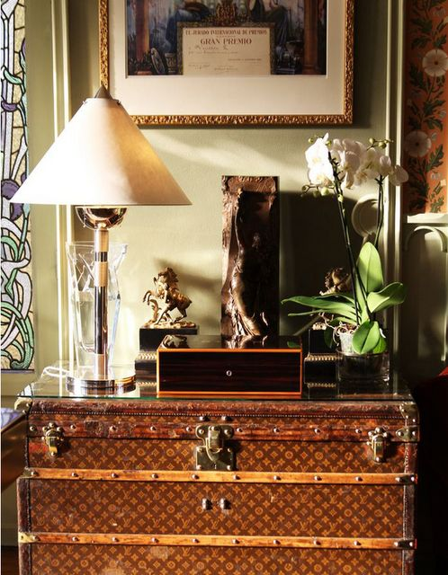 vignette with Louis Vuitton trunk.