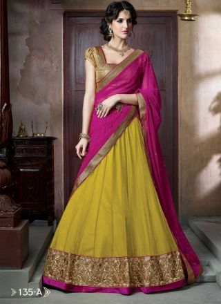 Pretty Yellow And Magenta Georgette Lace Border Work Lehenga Choli http://www.angelnx.com/Lehenga-Choli/Designer-Lehenga-Choli