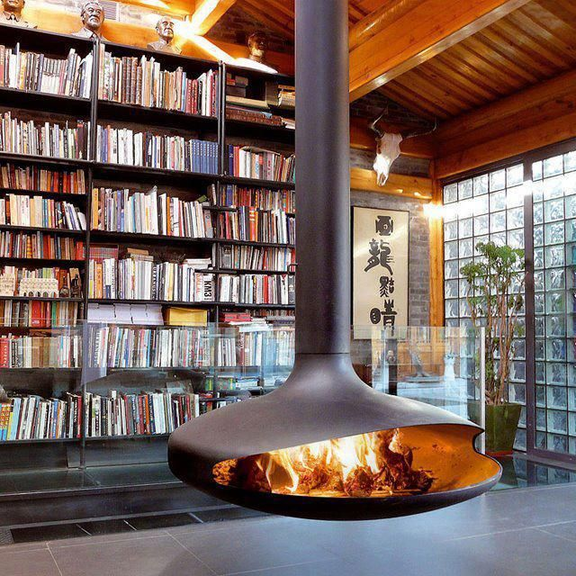 Living/Library - The new trend in fireplaces - free standing.  Gorgeous space with floor to ceiling book shelves and glass blocks for privacy but allowing natural light.  Lovely modern space.